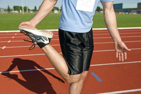 Male athlete stretches before race