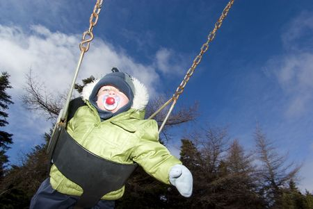 Baby Spring Schommel.Baby Swings In Park During Cool Spring Day Stock Photo Picture And