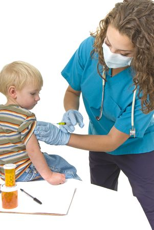 protective: Health care professional gives needle to anxious little boy Stock Photo
