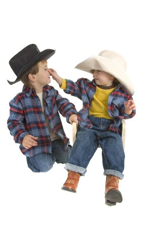 two cowboy brothers tease each other by pulling noses