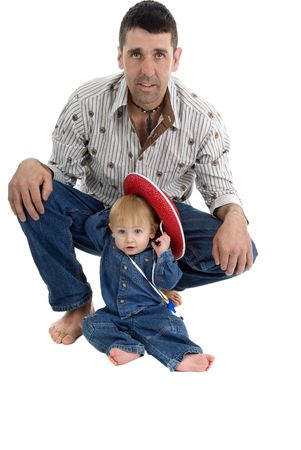Baby and father pose as cowboys for portrait Zdjęcie Seryjne