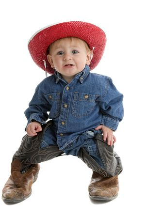 Adorable cowboy baby with big leather boots
