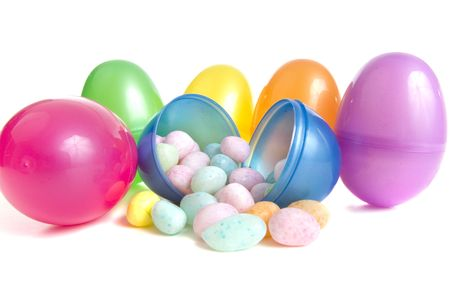Vibrant plastic easter eggs and pastel easter egg candies photo