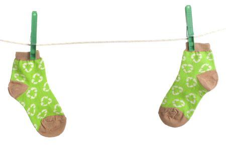 childs recycling symbol socks on laundry line. Energy conservation theme Zdjęcie Seryjne