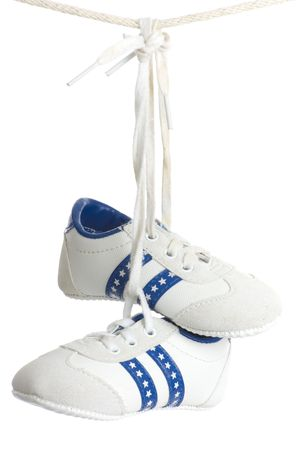 Little kids shoes hang on line