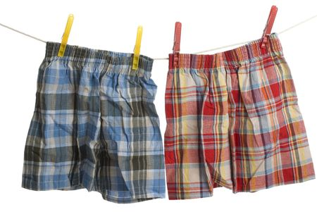 two pairs of Boxer shorts hang on laundry line