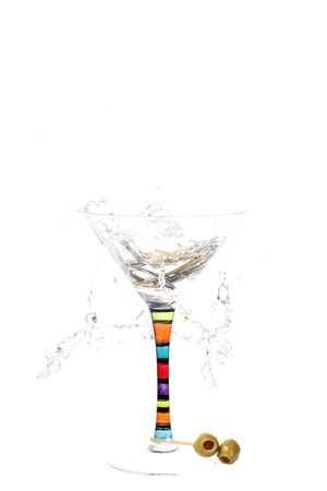 Keys dropped into a martini concept not to drink and drive