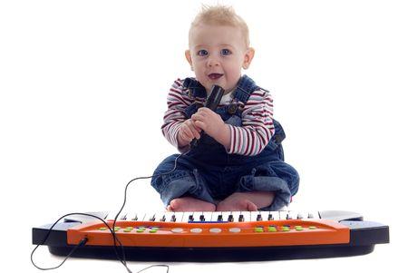 Musical baby plays the keyboard and sings karoke