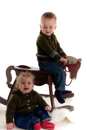 Adorable brothers play with rocking horse photo