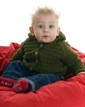 Expressive baby stares big eyed at camera