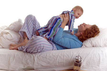 Mom & Baby enjoy special moment together in bed photo
