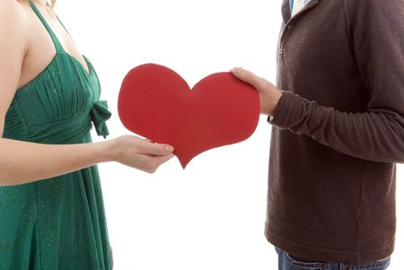 Couple hold a red heart