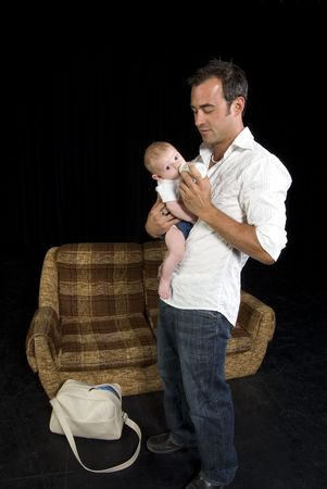 New Father tries to feed newborn bottle photo