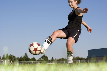 cleats: Playing soccer outside on beautiful summer day