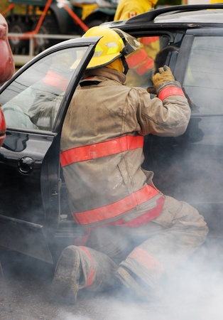 Fireman at the scene of a car accident.  Stock Photo