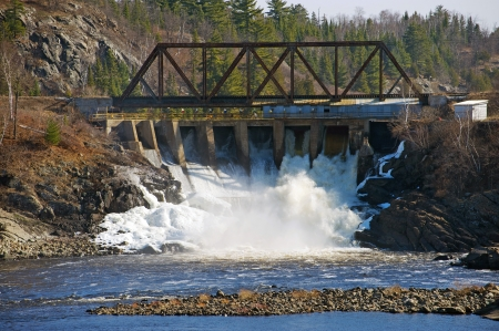 hazardous waste: View of the dam portion of a pulp and paper mill which uses energy, water and wood pulp to produce paper