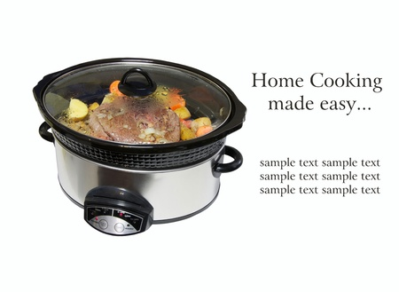crock pot: Nice image of a lightly browned seasoned blade roast with golden potatoes and chopped carrots simmering in a crock pot isolated on white with copy space   Stock Photo