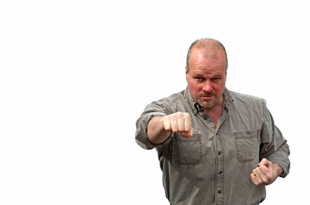 bad temper: An angry rough looking man throws a punch, isolated on white with copy space. Stock Photo