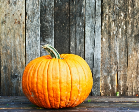 large pumpkin: Richly toned image of a pumpkin on a grunge wooden backdrop.  Stock Photo