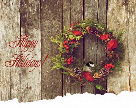 Christmas card with a pretty wreath and chickadee in the snow with text-Happy Holidays   Stock Photo