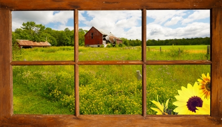 Beautiful country landscape seen through an old farmhouse window. photo