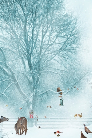 Humorous Christmas card design with birds, and other wildlife gathering around a bird feeder during a snow storm   photo
