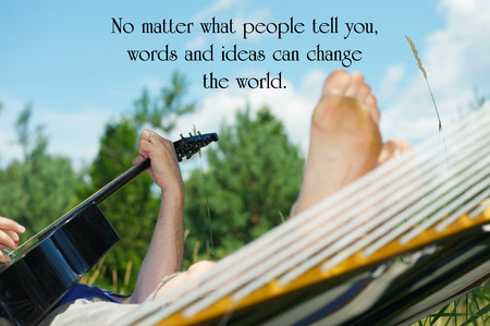 Inspirational quote on life, with a songwriter working on this art while relaxing in his hammock in the summer. Stock Photo