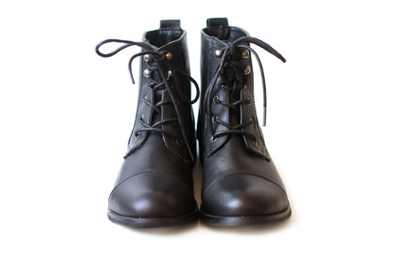 black boots: Pair of black boots on white background Stock Photo