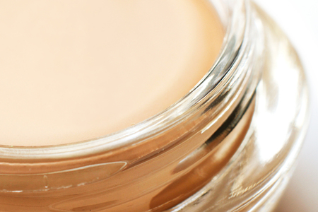tonal: Pink tonal cream in glass jar close-up fragment Stock Photo