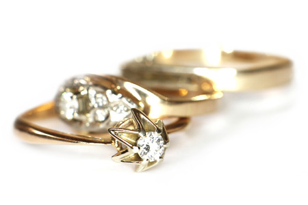 gold ring: Diamond rings on white background