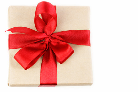 red ribbon bow: Gift box with red ribbon bow top view