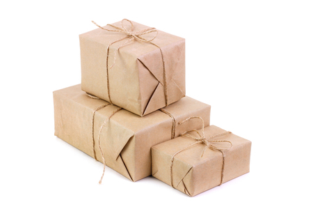 Three packages packed in kraft paper