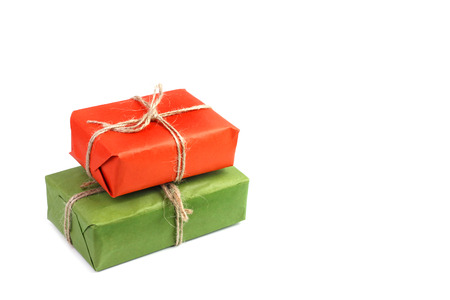 christmas gift: Gifts boxes in orange and green packaging on white background Stock Photo