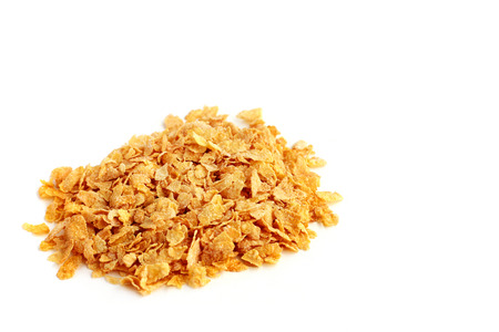 enriched: Heap of corn flakes on white background Stock Photo