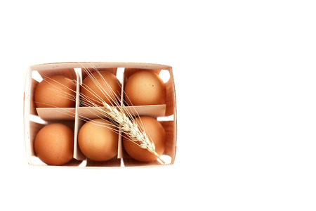 Fresh eggs with ear of wheat top view Stock Photo