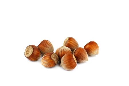 Whole hazelnuts isolated on white background
