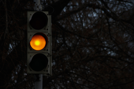 power cables: Traffic signal, yellow light at night