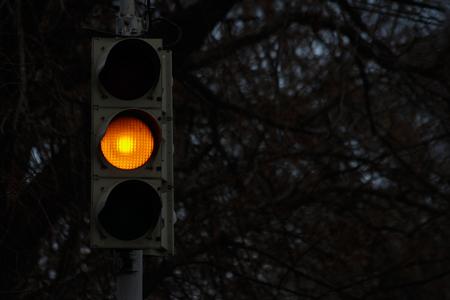 Traffic signal, yellow light at night