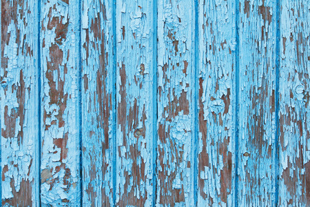 Old wooden fence with shabby blue paint 版權商用圖片