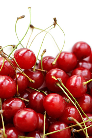Heap cherry fruits on white background