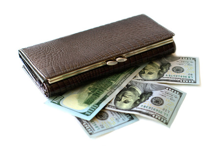 scrooge: Wallet and hundred dollar bills on white background