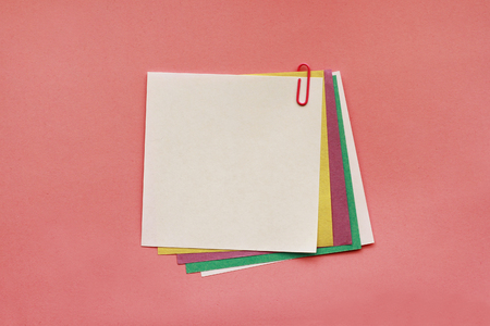 Note papers with clip on pink background 写真素材