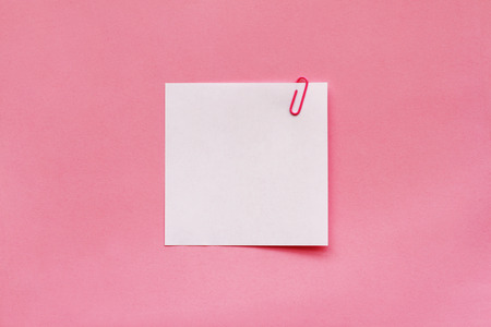 White note paper label with clip on pink background