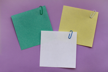 Note papers label with clips on purple background 写真素材