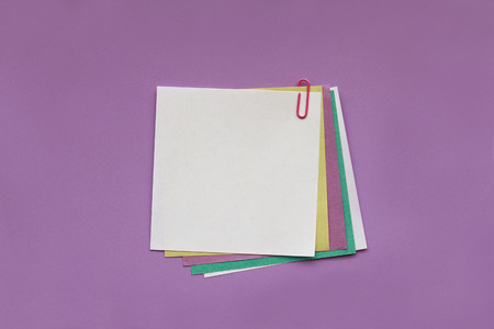 Blank note papers with clip on violet background 写真素材