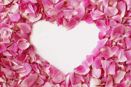 Pink rose petals make a heart shape for Valentines Day