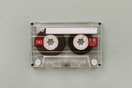 Audio cassette - analogue audio storage media. Audio cassette on gray background