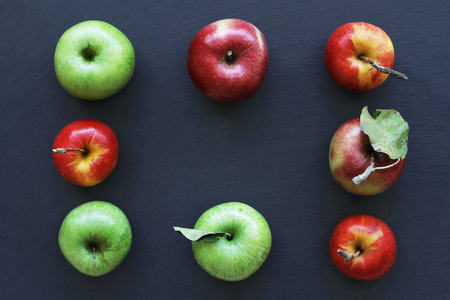 Apples on dark background, frame from ripe apples. Green and red apples 写真素材