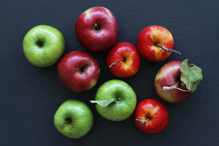 Apples on dark background, green and red apples 写真素材