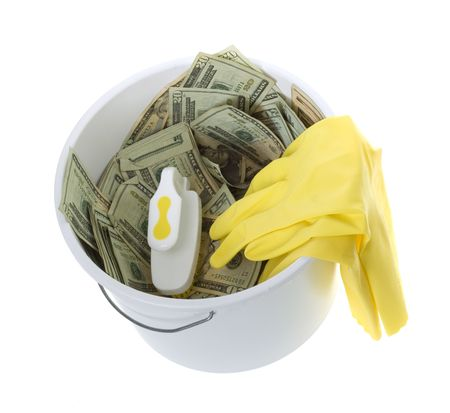 bucket of money: US Currency Twenty Dollar Bills inWhite Cleaning Bucket with scrub brush and yellow latex gloves,  isolated on white background.